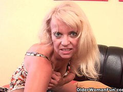Preview 1 of Granny In Stockings Fucks Herself With A Dildo