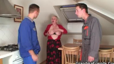 Two repairmen bang busty from both ends