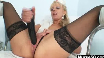 Old blonde milf stuffing pussy