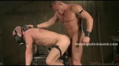 Gay hunk tied upside down receiving a hell of a spanking in extre