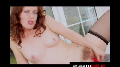 Redhead Rubs Her Hairy Pussy