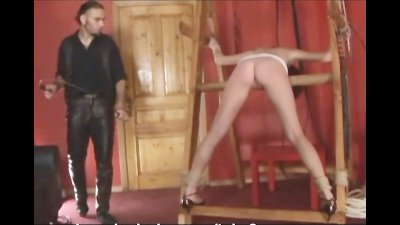 A perverted guy introduces busty neighbor to his handmade bondage stand