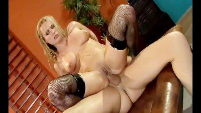 Oiled up hottie fucking in black fishnet stockings