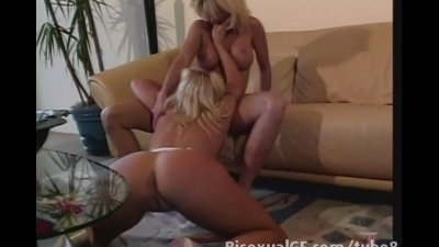 Two porn stars having sex on the couch