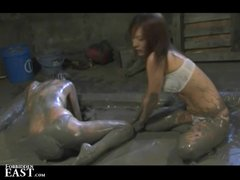 Japanese FemDom Mud Wresting With Sex Slave and Beating Her