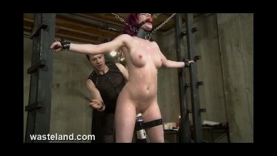 Redhead Submissive Chained To Rack, Whipped, Waxed and Made To Cum