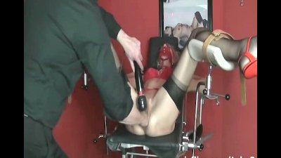 Fisting and vacuum pumping her massive snatch in bondage