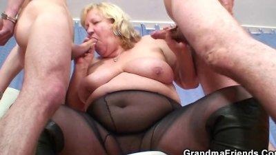 Huge grandma pleases two young cocks