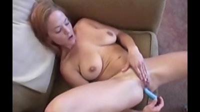 Busty Gabriella masturbates her pussy using her toy and fingers