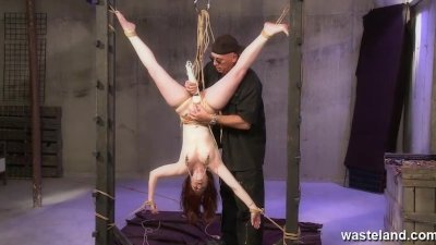 Tied up upside down and her pussy penatrated and vibrated