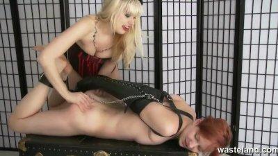 Blonde dominatrix uses her ginger female sex slave