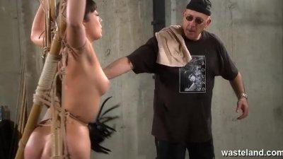 Older master ties and flogs Oriental slave girl