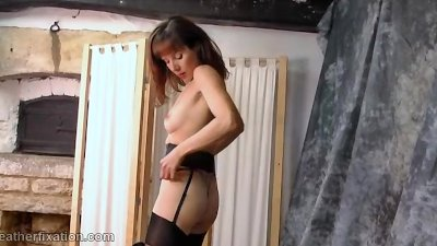 Kinky brunette milf strips off leather dress and reveals her tits and thong