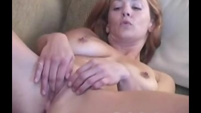 Busty amateur Gabriella striptease and playing her pussy