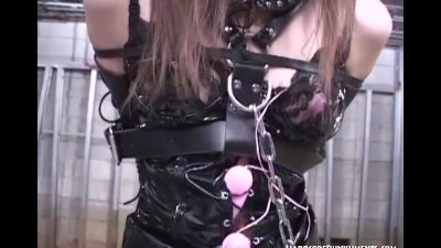 Oriental women has her pussy lips pegged in BDSM