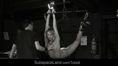Slutty slave girl suspended in a hardcore bdsm fantasy