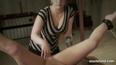 Mistress pushes fingers deep into her slave after bringing her to orgasm