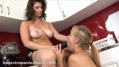 Sarah plows her petite blonde friend with a huge strapon dildo