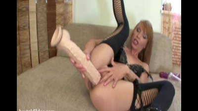 Vanda gapes her asshole with massive dildos