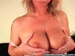 Squirting granny sprays her juice all over the couch