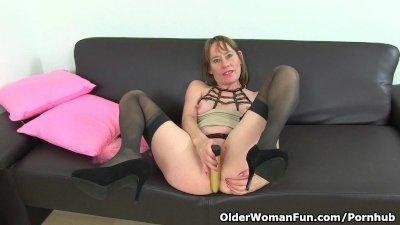 British milf Sexy P masturbates in stockings with suspenders