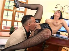 Sexy secretary fucked on a desk in ebony fishnet stockings and high heels