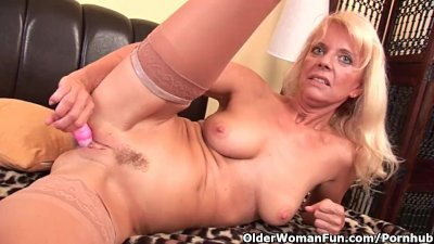 Granny In Stockings Fucks Herself With A Dildo