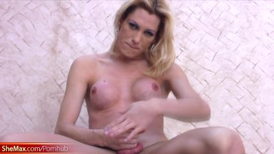 Tall shemale masturbates her shemeat on a granite pedestal