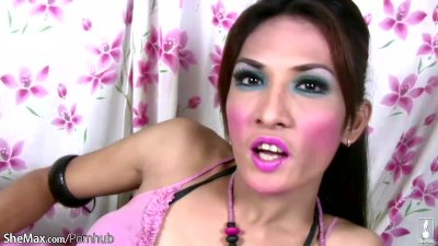 Pretty face ladyboy plays with small titties and shaved cock