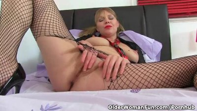 British milf Abi Toyne fucks herself with a dildo