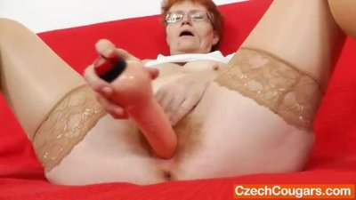Cougar solo with a sex toy
