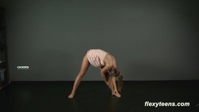 Brunette gymnast Zina shows how flexible she is