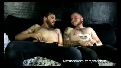Tatted scruffy cubs suck cock