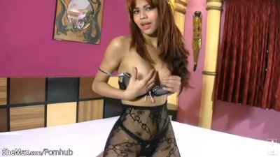 Redhead t-babe in black pantyhose masturbates her girl meat