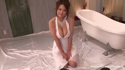 Sexy slut massages him with her big tits
