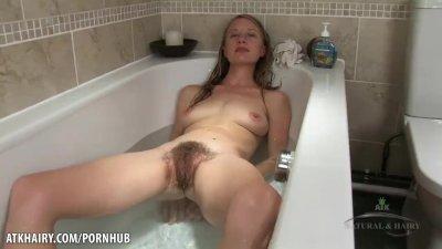 Selena soaks soaks her young hairy pussy