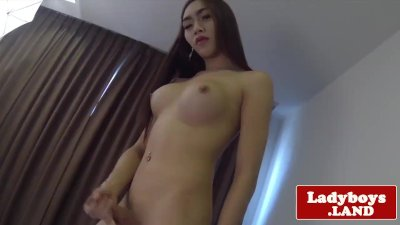 Gorgeous busty ladyboy solo rubbing her cock